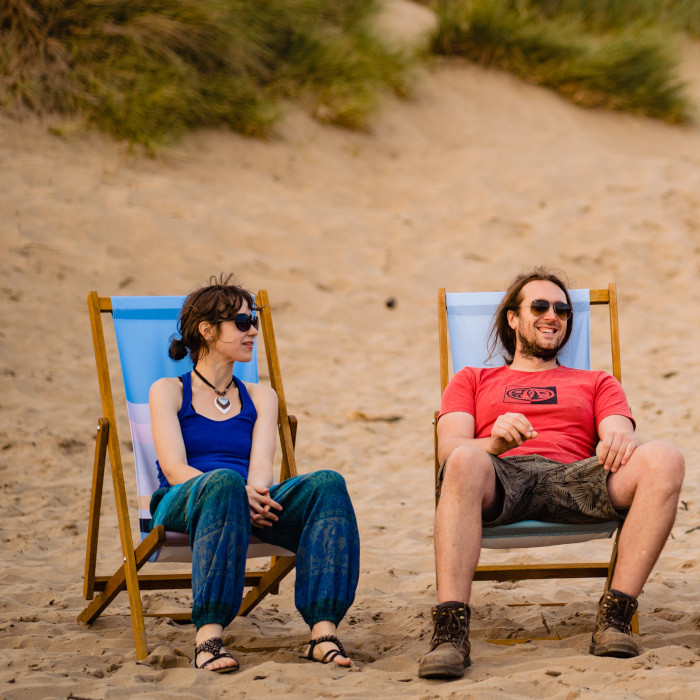 Two friends enjoying deckchairs