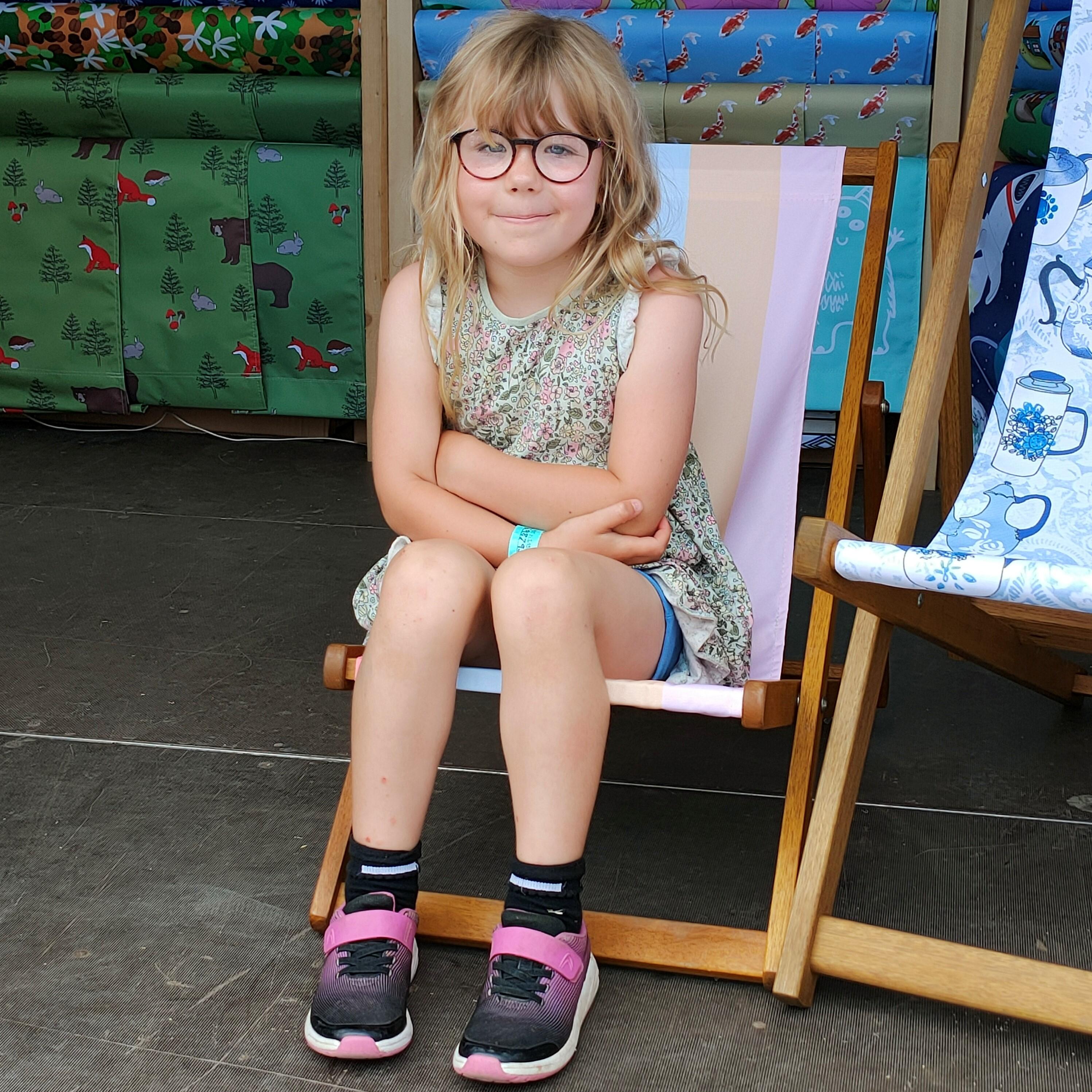 Child sat in junior size deck chair