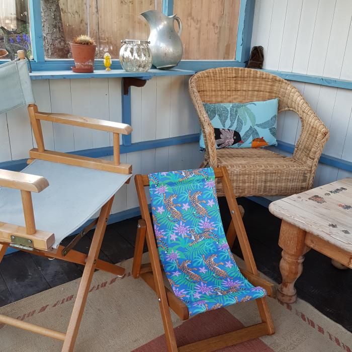 Tiger print kids deckchair in summerhouse