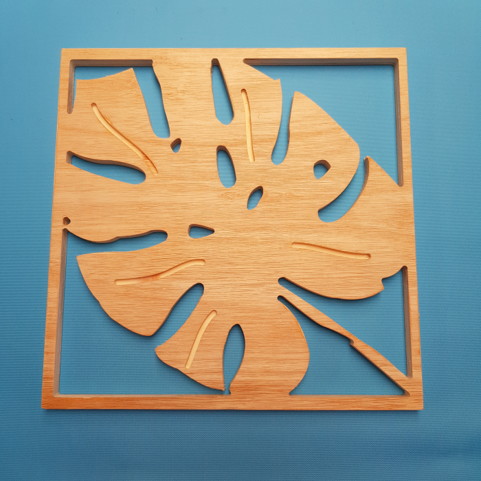 Monstera plant leaf cut out of wood