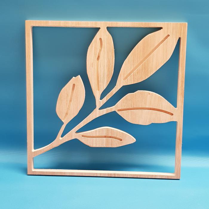Hoya plant leaf cut out of wood