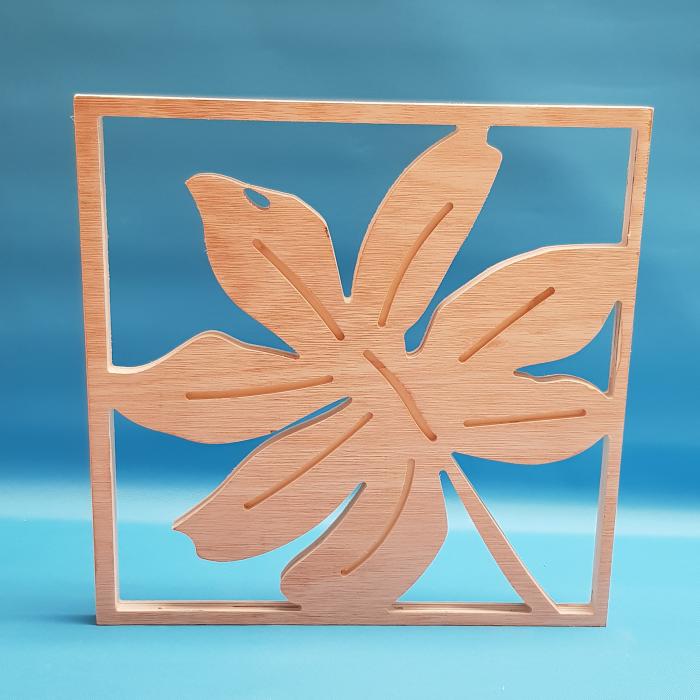 Castor plant leaf cut out of wood
