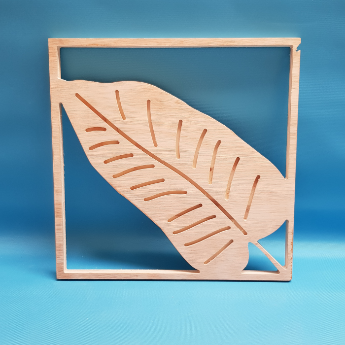 Banana plant leaf cut out of wood